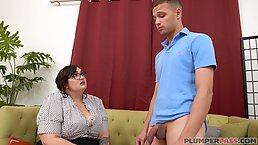 Voluptuous brunette with glasses is getting fucked from the back and giving a titjob to her guy