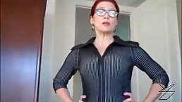 Red haired mature in shoes with high heels is about to play with a stiff cock